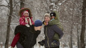 Happy family during a snowfall stock video footage