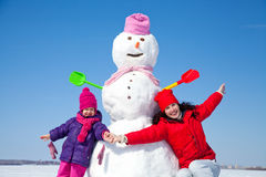 Happy family with snowman Stock Photo