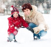 Happy family with snowman. Winter portrait Royalty Free Stock Photos