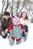 Happy family in snowy winter park Royalty Free Stock Photography