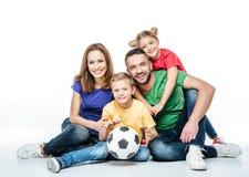 Happy family with soccer ball Stock Photo