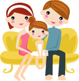 Happy family on sofa Stock Image