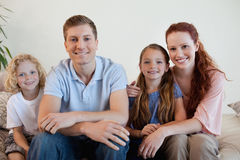 Happy family on the sofa Royalty Free Stock Photo