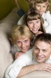 Happy family on sofa royalty free stock photos