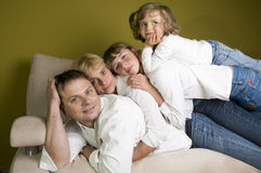 Happy family on sofa Stock Photo