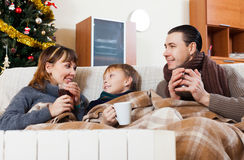 Happy family on sofa at Christmas time Royalty Free Stock Images