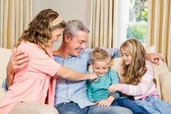 Happy family on the sofa Royalty Free Stock Image