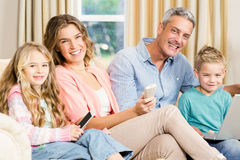 Happy family on the sofa Royalty Free Stock Photo