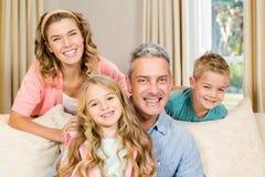 Happy family on the sofa Stock Photos
