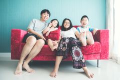 Happy family on sofa in the room stock photography