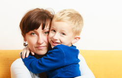 Happy family. Son boy kid hugging mother expressing feelings. Royalty Free Stock Images