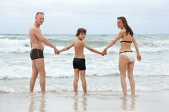 Happy family with son having fun in water Stock Photography