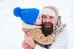 Happy Family Son Hugs His Dad On Winter Holiday. Daddy And Boy Smiling And Hugging. Merry Christmas And Happy New Year Stock Photos