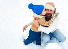 Happy Family Son Hugs His Dad On Winter Holiday. Merry Christmas And Happy New Year. Daddy And Boy Smiling And Hugging. Stock Photography