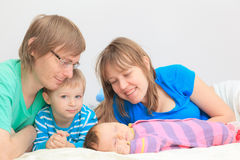 Happy family with son and newborn daughter Royalty Free Stock Photography