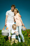 Happy family with the son and picnic Royalty Free Stock Images