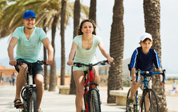 Happy family with son riding bicycles Stock Photo