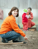 Happy family sows seeds in soil Royalty Free Stock Image