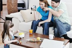 Happy family special moments on video. Young happy family recording by video camera their child at home Stock Photography