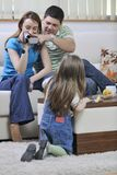 Happy family special moments on video. Young happy family recording by video camera their child at home Royalty Free Stock Images