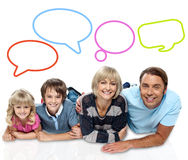 Happy family with speech bubbles. Smiling family of four with speech bubbles Royalty Free Stock Images