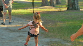 Happy family spend leisure time in the rope park stock video