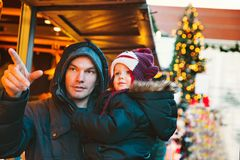 Happy family spend time at a Christmas and New Year holidays. In the old town of Klagenfurt, Austria. Holidays, Christmas, Family concept. Father and son at Royalty Free Stock Photo