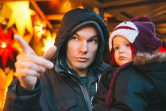 Happy family spend time at a Christmas and New Year holidays. In the old town of Klagenfurt, Austria. Holidays, Christmas, Family concept. Father and son at Royalty Free Stock Photos