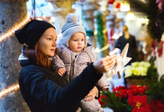 Happy family spend time at a Christmas and New Year holidays. In the old town of Salzburg, Austria. Holidays, Christmas, Family concept. Mother and son at Stock Photos