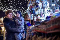 Happy family spend time at a Christmas street market fair in the Royalty Free Stock Photography