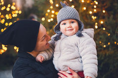 Happy family spend time at a Christmas street market and fair Royalty Free Stock Photo