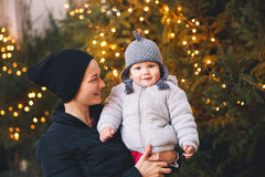 Happy family spend time at a Christmas street market and fair Royalty Free Stock Images