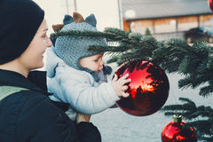 Happy family spend time at a Christmas street market and fair Royalty Free Stock Photography