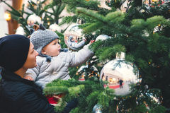 Happy family spend time at a Christmas street market and fair Royalty Free Stock Image