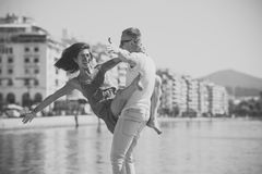 Happy family spend time together, dancing, having fun, sea and urban background. Couple in love stand on seafront Royalty Free Stock Photo