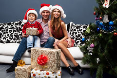 Happy family spending Christmas time Stock Photo