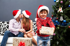 Happy family spending Christmas time Stock Image