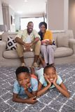 Happy family spending leisure time at home. Portrait of happy family spending leisure time at home Stock Photo