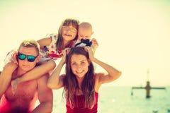 Family posing at beach near sea Royalty Free Stock Photography