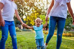 Happy family spending time outdoors playing in park. Mom having fun with two kids. Walking with toddler. Family values. Happy family spending time outdoors royalty free stock image