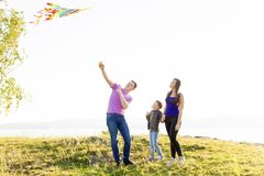 Family in a park. A happy family spending time outside together royalty free stock photo