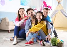 Happy family spending time together during Easter holiday. At home stock photography
