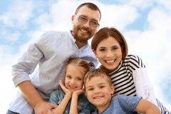 Happy family spending time together. With their children outdoors royalty free stock photography