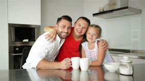 Happy Family Spending Time Together. They Have a Lot of Fun Sitting and Talking on Modern Kitchen. stock video