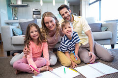 Happy family spending time together. At home in the living room Royalty Free Stock Photography
