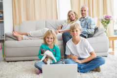 Happy family spending time together. At home in the living room Royalty Free Stock Photo
