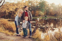 Happy family spending time together outdoor. Lifestyle capture, rural cozy scene. Father, mother and son walking in forest royalty free stock photos
