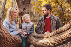 Happy family spending time together outdoor. Lifestyle capture, rural cozy scene. Father, mother and son walking in forest stock image