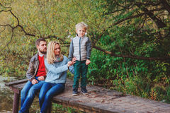 Happy family spending time together outdoor. Lifestyle capture, rural cozy scene. Father, mother and son walking in forest royalty free stock photo