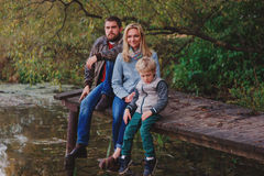 Happy family spending time together outdoor. Lifestyle capture, rural cozy scene. Father, mother and son walking in forest royalty free stock images
